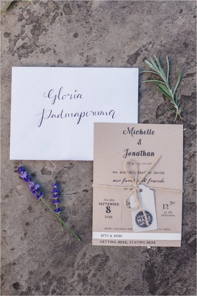 Rustic calligraphy wedding invitations and lavender