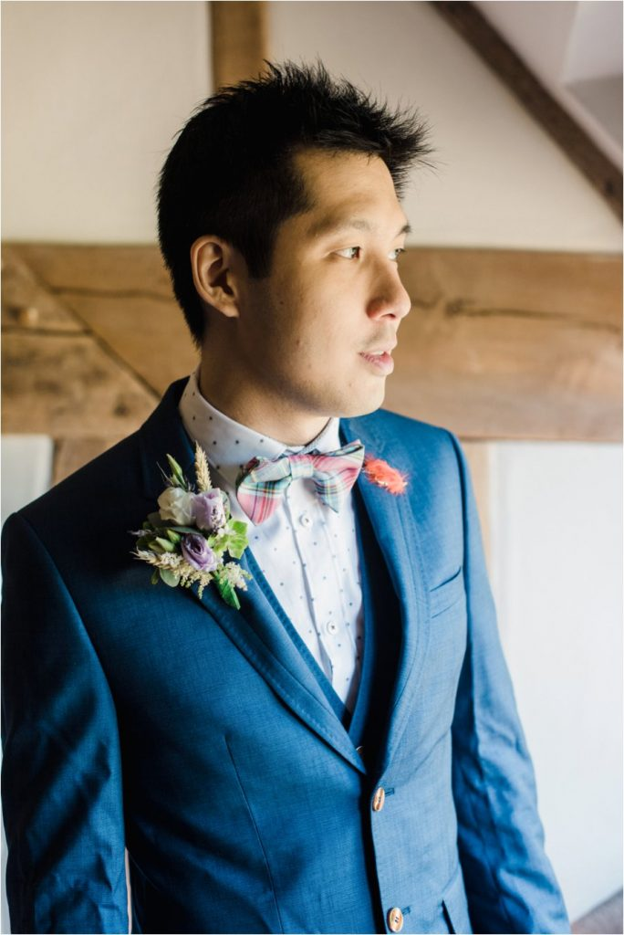 groom wearing a ted baker suit for his wedding at Cain Manor